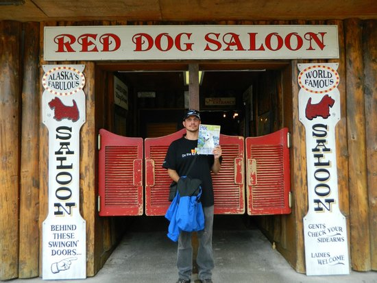 Red Dog Saloon: Cory  at the  Red Dog in  Juneau sporting our favorite  pet magazine - lol