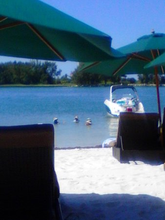 DreamView Beachfront Hotel & Resort: boat dock on beach area.. anchor in swimming area of beach