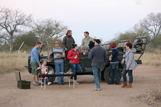 Africa on Foot Camp: Sundowner drinks on a Safari Game Drive