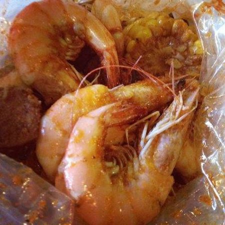 Boiling Crab: Dinner in a bag: Shrimp, sausage, corn.. in the Shabang Sauce