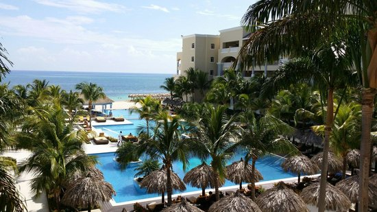 Iberostar Grand Hotel Rose Hall: View if the pool and ocean from the lobby bar balcony.