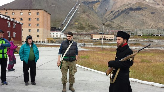 Pyramiden : Our guide Sasha (right). Our other guide joins us. Wish I knew his name! You can see the coal mi