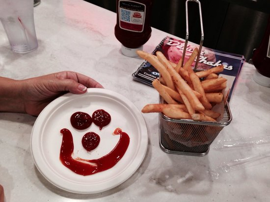 Johnny Rockets: Waitress made smiley face from catsup for the scrumptious French fries!!!!