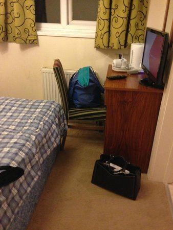 Stockwood Hotel: single room was tight couldn't manoeuvre the chair, solution is to climb over the bed!