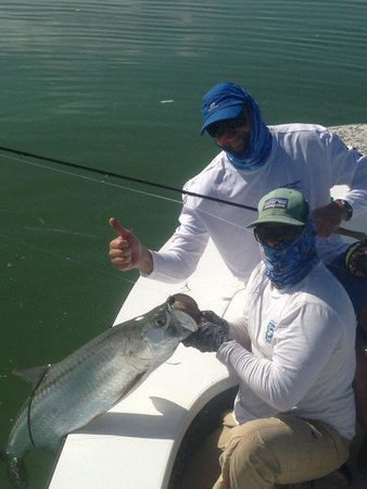Shallow Tails Guide Service: My dad's first tarpon .. And got it on the fly !