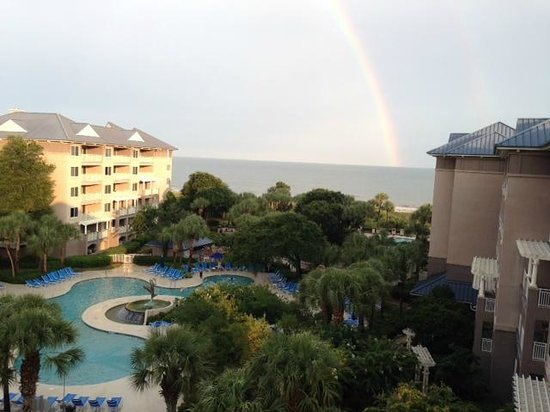 Marriott's Grande Ocean : View of the Dolphin pool and Atlantic from our balcony -following the afternoon shower a rainbow