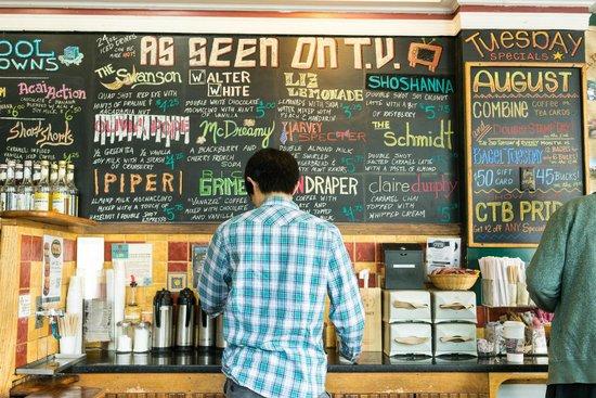 Collegetown Bagels : a wall of seasonal drinks