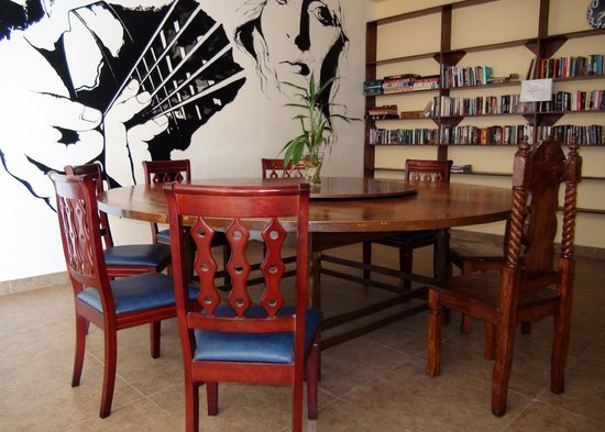 Squares Cafe & Apartments: Free to use table and reading area