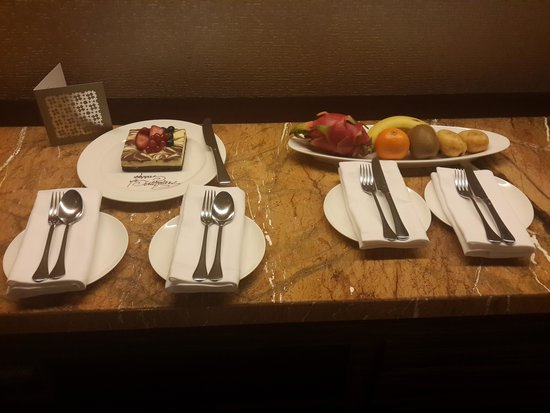 Hotel ICON: The cake and fruit platter for my husbands birthday.