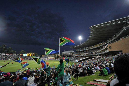 Illovo, South Africa: Crowd at Bidvest Wanderers Stadium grass embankment