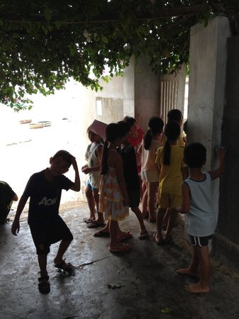 Life's a Beach: Local children arriving for their English lesson.