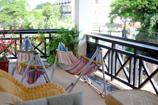 The Siem Reap Hostel: one of the chill area with 2 hammocks and few other seats on  2nd floor
