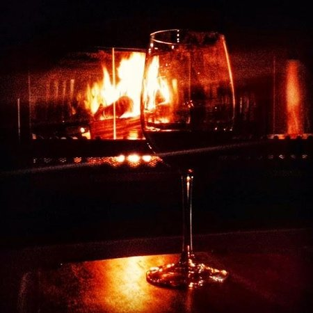 Apple Tree Guest House: Wine by the fireplace