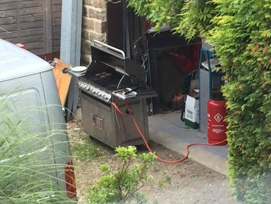 The Grange : Home-made burgers being grilled