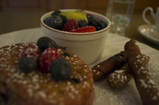 1837 Bed and Breakfast: Our delicious breakfast item, Raspberry stuffed French Toast with Sausage links and fruits