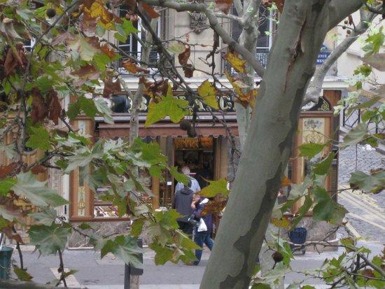 Hotel de la Porte Doree : View of bakery over the road