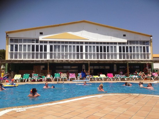 Caleta Dorada : The main restaurant & medium pool area.