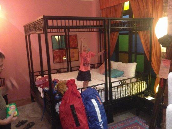 Shanghai Mansion Bangkok: A bed big enough to fit us three!