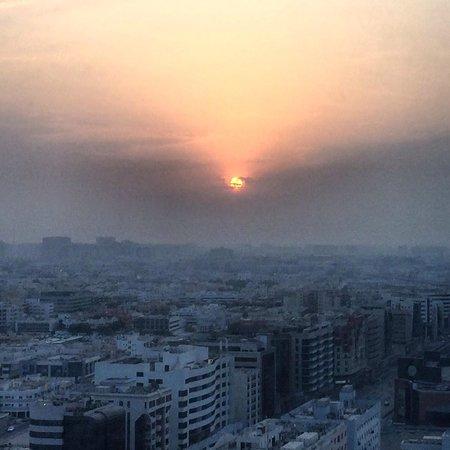 Al Ghurair Rayhaan Dubai: Room with a view. Sunrise over Dubai.
