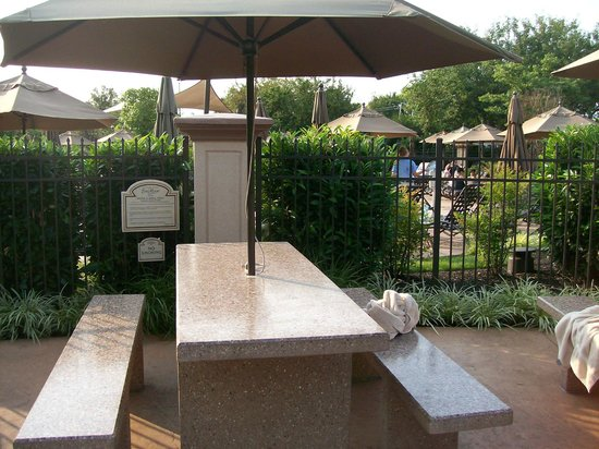 Eden Resort & Suites, BW Premier Collection: Outdoor Patio Seating near Grills and Outdoor Pools