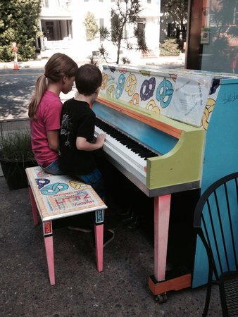 Piano outside Dosie Dough's begs patrons to play.