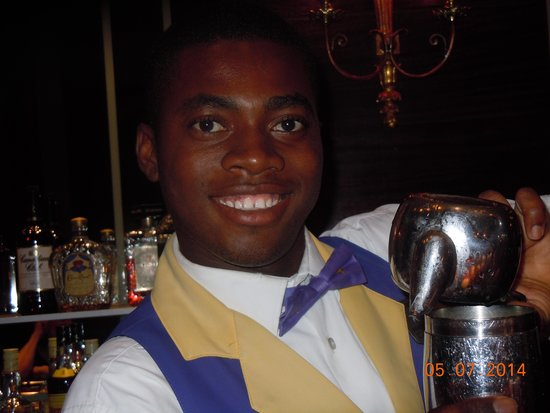 Iberostar Grand Hotel Rose Hall: lots of laughs with this guy in the lobby bar.  Miss your smile