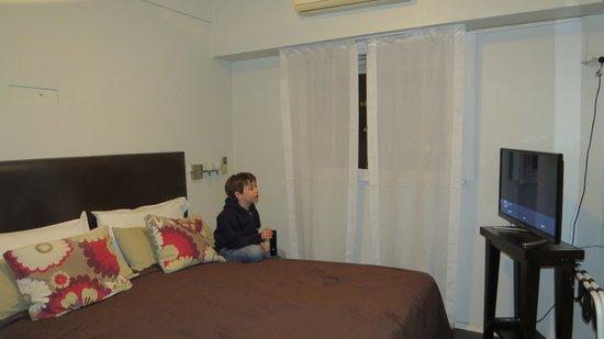 Sarmiento Suites Apartment Hotel: Habitación con cama matrimonial