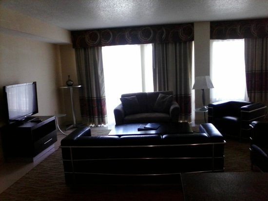 3 Palms Oceanfront Myrtle Beach: Living Room area, Sofa, couch, Coffee Table, TV, 2 chairs & balcony