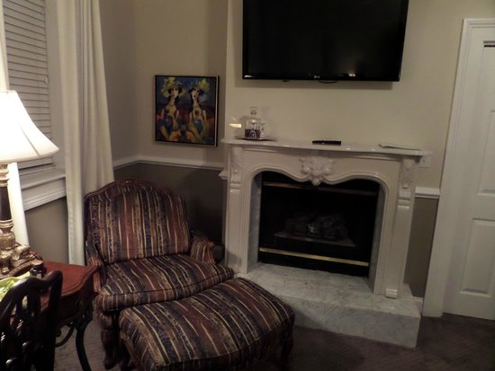 The Vendue Charleston's Art Hotel : Comfy chair near fire place in our room.
