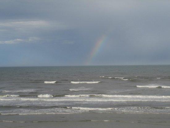 Sea Club IV: Rainbow over the ocean.