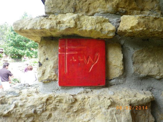 Taliesin Preservation: FLW's initials on cherokee red stone in wall