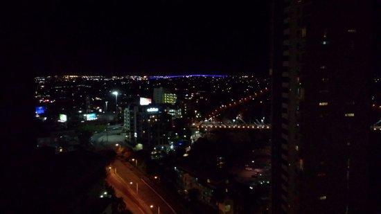Meriton Suites Adelaide Street, Brisbane: Night view across Brisbane, purple lights are the Gateway Bridge