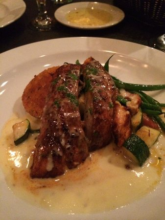 Clemenza's at Uptown: Blackened redfish with brown butter sauce over Chipotle grit cake