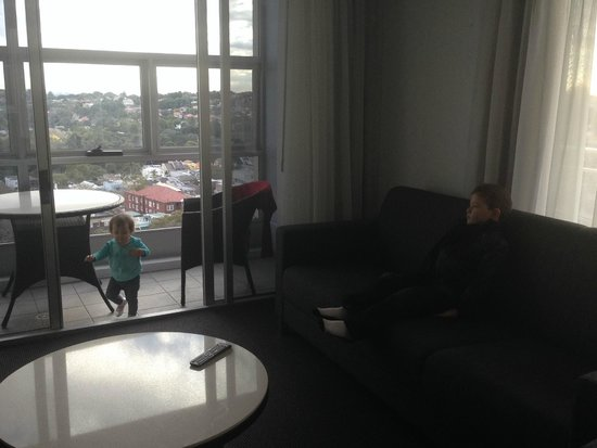 Meriton Suites Bondi Junction: lounge area looking thru to enclosed terrace (room is very sunlight filled just this photo is da