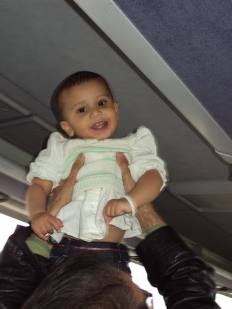 Best of Switzerland Tours: Sweet little Trisha enjoying the beautiful and most comfortable ride in the coach on the Highway