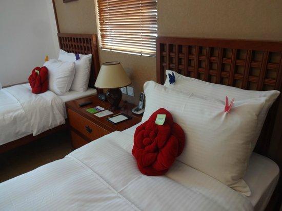 Butterfly on Wellington: お部屋。枕には蝶の飾りが♪