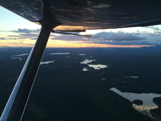 5 Lakes Lodge: View of the region at sunset from the plane
