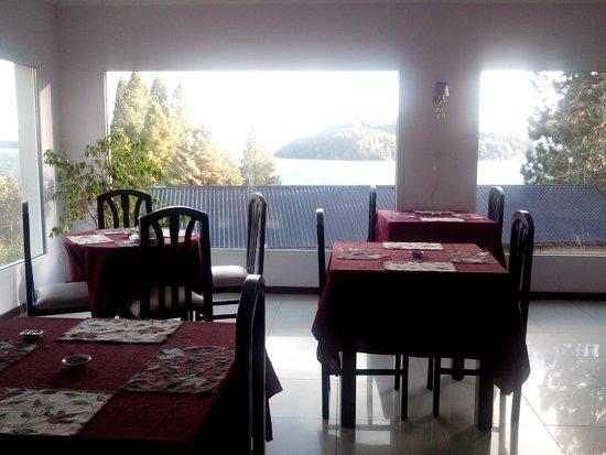 Altuen Hotel Suites&Spa: área para alimentação com uma vista maravilhosa