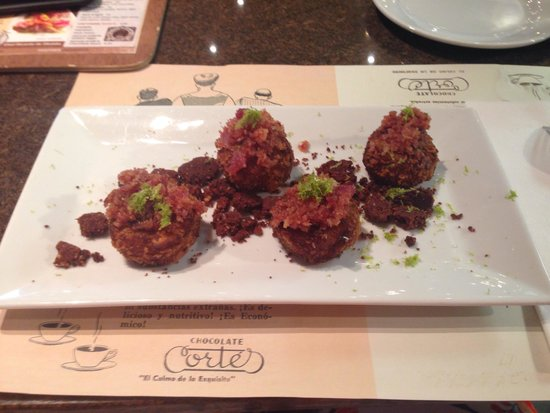 Casa Cortés: Mofongo tapas filled with chocolate, topped with bacon, and garnished with lime.