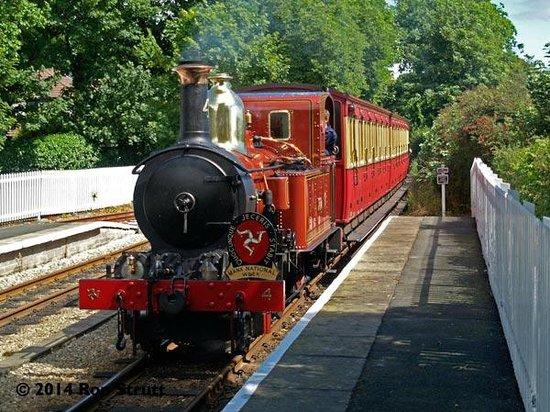 Isle of Man Bus and Rail: An Isle of Man Steam Railway train arrives at Ballasalla, hauled by engine no 4