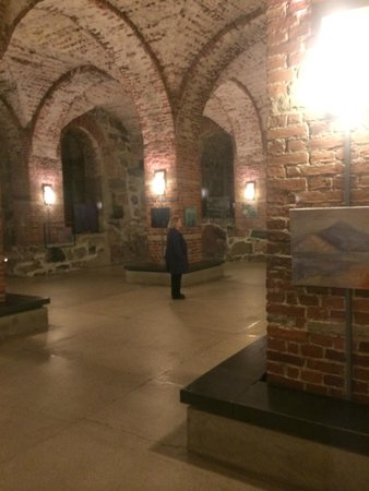 Helsinki Cathedral: Area of the crypt in front of the cafe with hanging art.