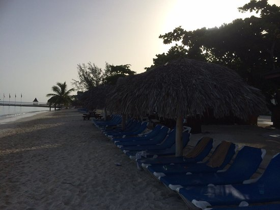 Sandals Montego Bay : Early morning beach chairs and cabanas.