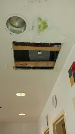 Hampton Inn and Suites Denver-Cherry Creek: Hole in ceiling with exposed piping in pool area