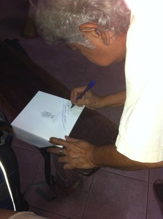 The Artists' Place: Charlie signing our complementary copy of his book of art.