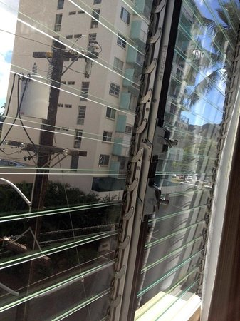 Queen Kapiolani Hotel : Windows in our room. Great for hanging swimmers to dry, but does let in noise as cars go past.