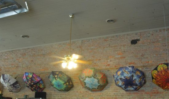 Veranda Cafe & Gifts: Loved the umbrellas displayed on the wall -- all designs for sale
