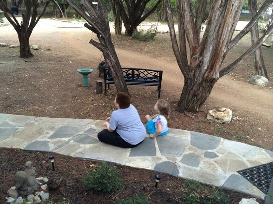 Cypress Creek Cottages: Watching the birds in front of our deck