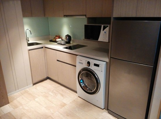 Small Kitchen with electric stove, microwave, washer+dryer ...