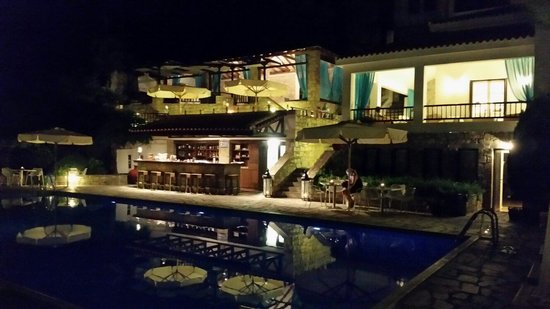 Aegean Suites pool and bar at night