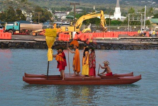 Island Breeze Luau: King Kamehameha's royal court enters by canoe
